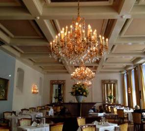 and main dining room of the Grand Hotel Karel V
